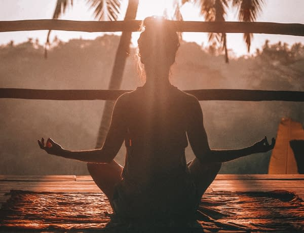 woman meditating nature health wellness Holistic Wellness: 12 Ways to Start Your Journey
