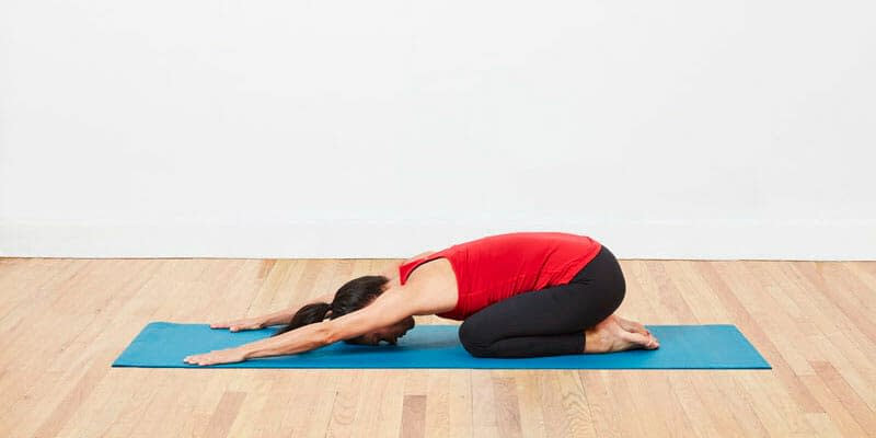 Child's Pose (Balasana) - 9 Yoga Poses that Relieve Menstrual Cramps (With Variations)