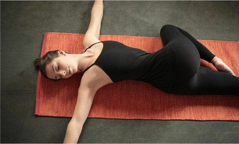 Reclined Spinal Twist/Supine Twist (Supta Matsyendrasana) - 9 Yoga Poses that Relieve Menstrual Cramps (With Variations)