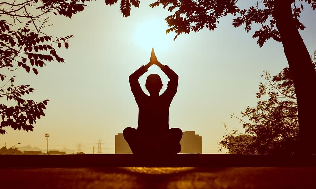 Woman practicing meditation to strengthen intuition
