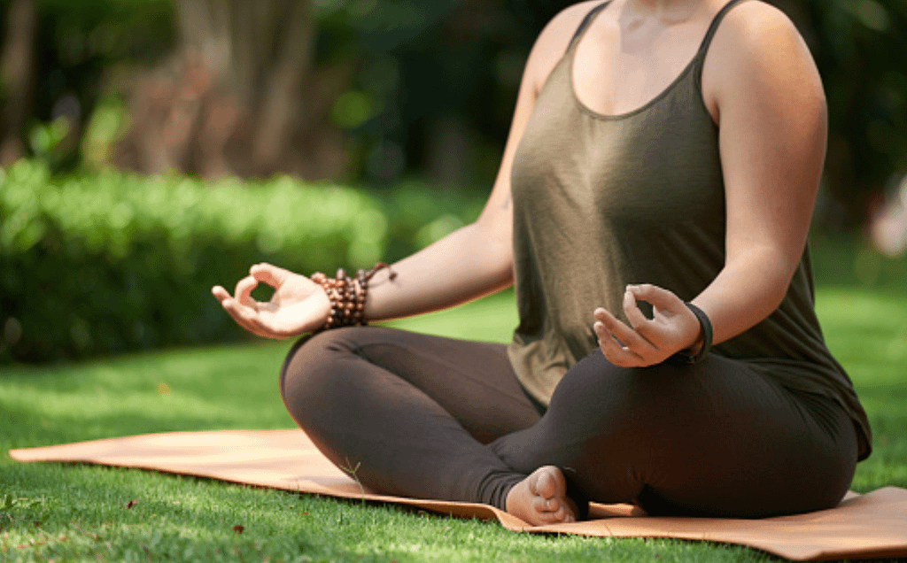 meditating lotus pose 1 Body Positive Yoga: 5 Things You Should Know