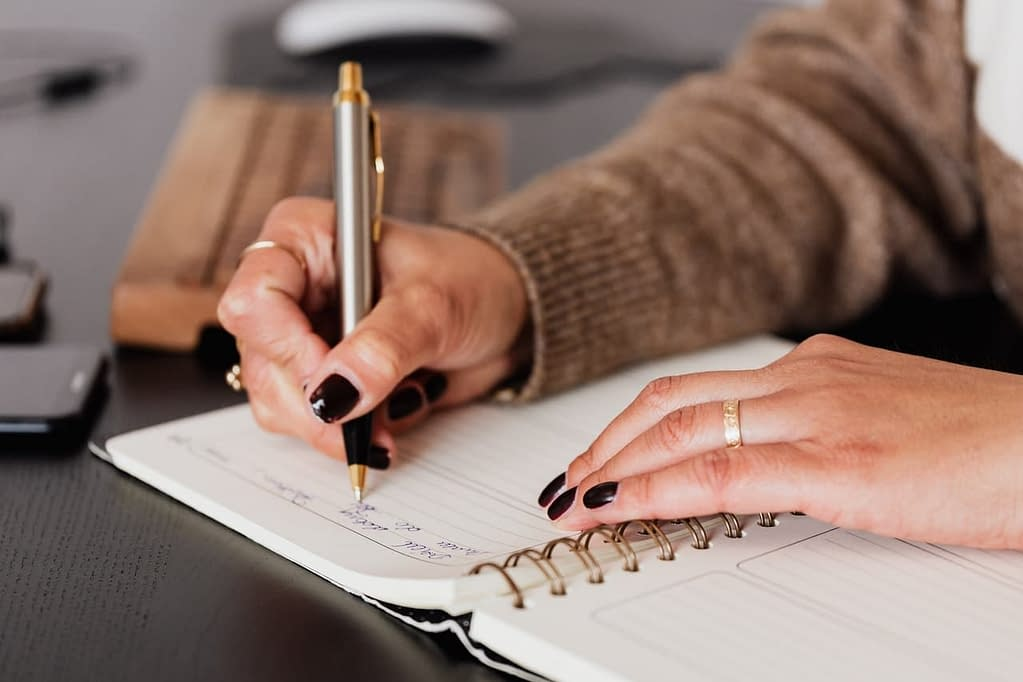 Person journaling their thoughts to sharpen intuition