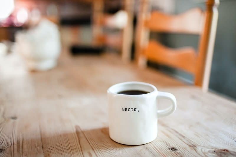 coffee on table Holistic Wellness: 12 Ways to Start Your Journey