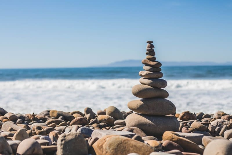 stacked rocks beach Holistic Wellness: 12 Ways to Start Your Journey