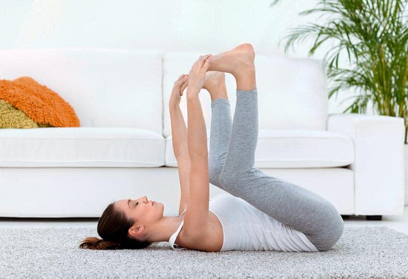 Happy Baby Pose (Ananda Balasana) - 9 Yoga Poses that Relieve Menstrual Cramps (With Variations)
