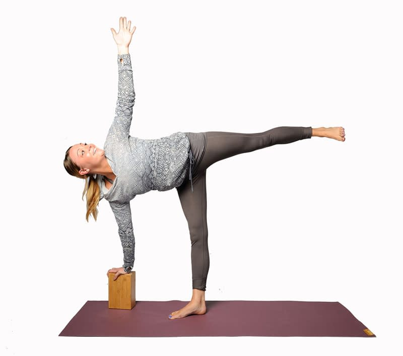 half moon pose with block 5 Essential Yoga Props You Should Own (Plus Extras)