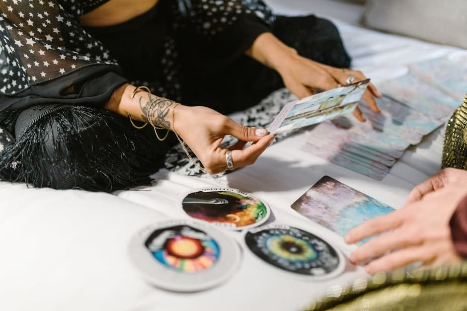 Woman giving a tarot card reading to a client