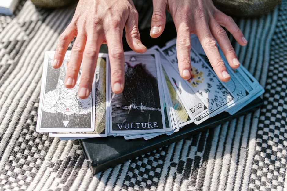 Woman with hands over a tarot deck